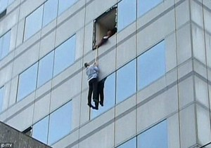 "attempting to escape from a building during Earthquake in Christchurch (NZ).  ""what if he has a rope!?"""